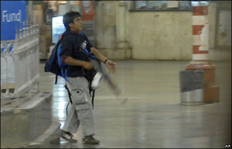 A gunman walking through the Chhatrapati Shivaji railway station