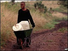South African boy collecting water