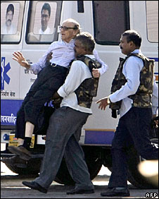 A man being carried from the Taj Mahal hotel, 27 November 2008