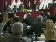 Iraqi parliamentarians vote on the US troop deal