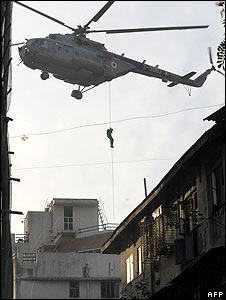 Commandos abseil from a helicopter onto the roof of the Jewish centre in Mumbai