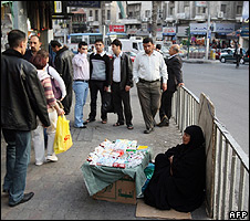 Iraqi refugee woman selling cigarettes in Amman, Jordan