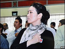 Gong Li at a citizenship ceremony in Singapore (08/11/08)