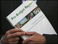 Alistair Darling holds the pre-Budget report document