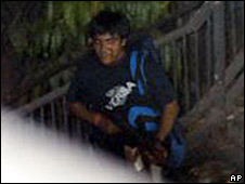 A suspected attacker seen outside the Chhatrapati Shivaj on 26 November 2008