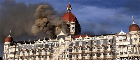 Smoke billows above the Taj Mahal hotel in Mumbai