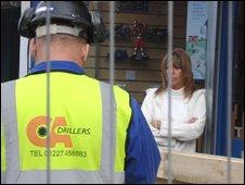 Builder outside Dena and Martin Rose's shop