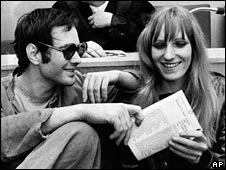 Andreas Baader, left, and Gudrun Ensslin joke during their trial in Frankfurt, 1968