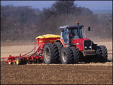 Farmer sowing cereal crop in Oxfordshire, UK