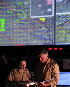 Military personnel at the US Air Force Combined Air and Space Operations Centre