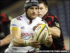 Ospreys Marty Holah gets tackled by Edinburgh's Allister Hogg