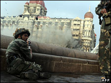 Soldiers wait outside the Taj Mahal hotel in the last hours of the assault