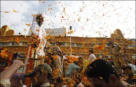 People throw flower petals as the body of Hemant Karkare, the chief of Mumbai's Anti-Terrorist Squad, is taken for cremation in Mumbai.