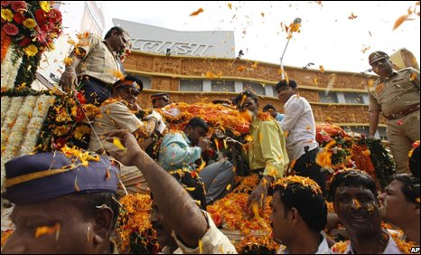 "People standing on the roadside shower flower petals as the body of Hemant Karkare, the chief of Mumbai""s Anti-Terrorist Squad is taken for cremation in Mumbai, India, Saturday, Nov. 29, 2008."