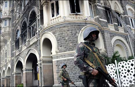Indian soldiers stand guard at the Taj Mahal hotel