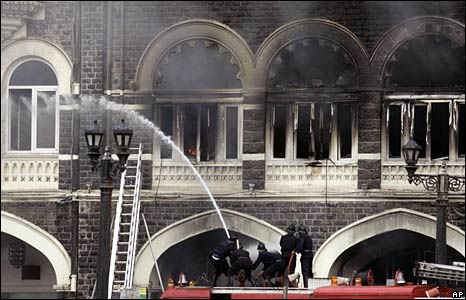 Firemen douse flames at the Taj Mahal hotel