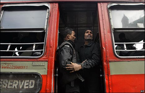 Two commandos stand in a bus after the Taj Mahal siege ends
