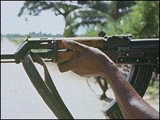 Tamil Tiger rebel holding a gun, Sri Lanka, 1980s