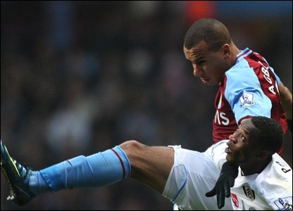 Aston Villa's Gabirel Agbonlahor clashes with John Pantsil as the game gets under way in Birmingham