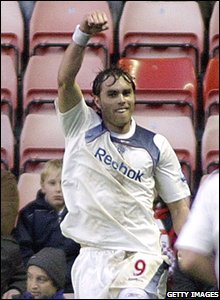 With good reason as Bolton striker Johan Elmander does his best Superman impression to celebrate the first of his two goals