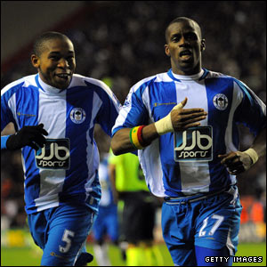 But the lead does not last long and Henri Camara is soon celebrating his equaliser with Wilson Palcios