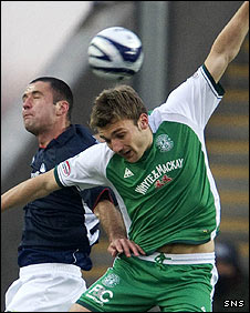 Michael Higdon and Chris Hogg challenge at Falkirk Stadium
