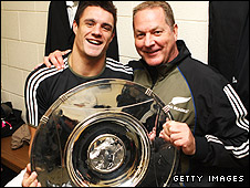 Dan Carter and All Blacks skills coach Mick Byrne celebrate