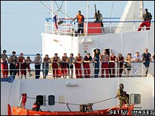 Pirates stand guard over the crew of the MV Faina, in an image released by the US Navy on 9 November 2008