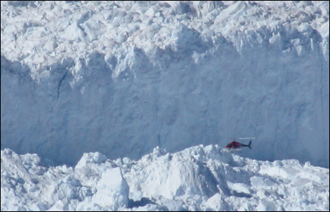 Helicopter flying in front of the rim of the Ikertivaq glacier (Pic: Iolo ap Dafydd)