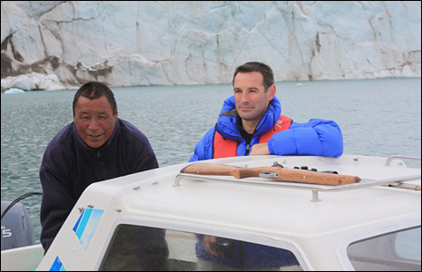 Innuit hunter Pele Maratse and Iolo Ap Dafydd on Mr Maratse's boat near the Apusiaji glacier (Pic: Swansea University).