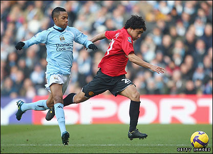Rafael sprints away from City's Robinho