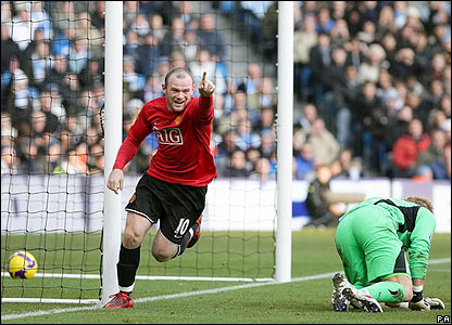 Wayne Rooney celebrates scoring the opener for United