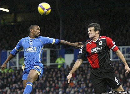 Pompey striker Jermain Defoe makes an aerial challenge against Ryan Nelsen