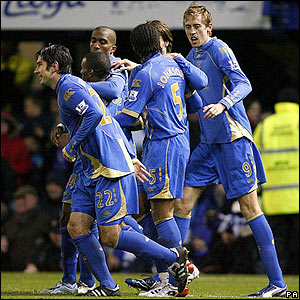 Peter Crouch is congratulated by his team-mates