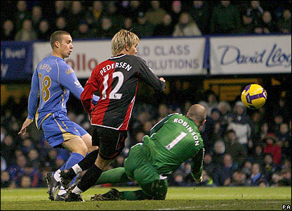 Sean Davis puts Pompey ahead - flicking the ball over Robinson