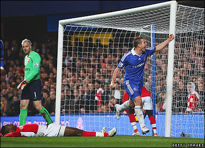 Arsenal's Johan Djourou lies on his back after scoring an own goal