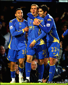 Sean Davis is mobbed by his Portsmouth team-mates