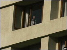 man looks out of window at the Oberoi