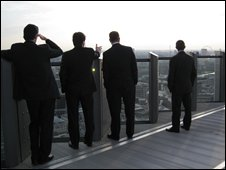 Businessmen survey City of London view