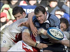 Rory Lamont battles for possession with England's Jonny Wilkinson