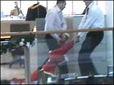 A protester being taken from the building