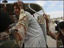 Troops rescue a Pakistani boy from a troubled area of Karachi on Monday, December 1, 2008.