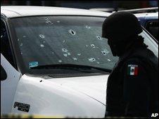 Bullet-riddled car in Tijuana (25 Nov 2008)