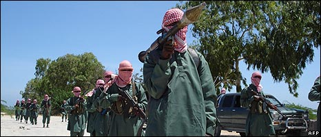 Al-Shabab fighters display their weapons