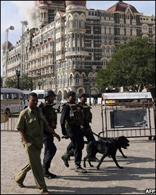 Commandos with sniffer dogs outside the Taj Mahal Hotel
