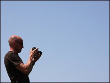 Man using digital camera, BBC