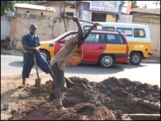 Worker repairing water mains