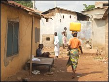 Woman carrying water in Accra township