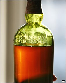 Whisky bottle being sold at auction