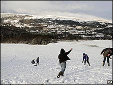 Children playing the snow in Bury